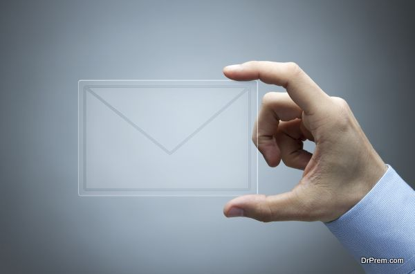 Human hand holding futuristic transparent mail icon