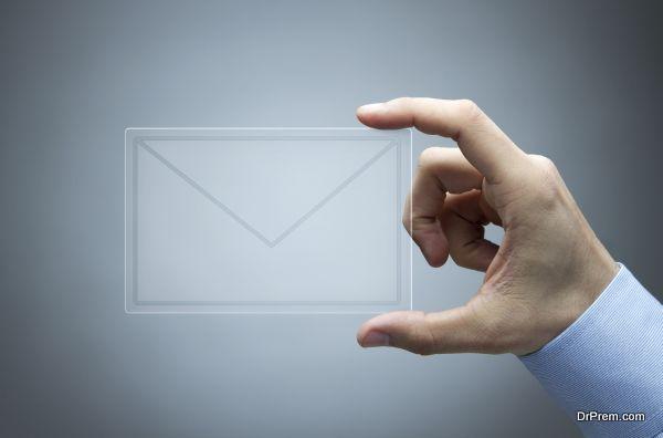 Human hand holding futuristic transparent mail icon