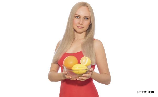 Blonde model in red with plate of fruits