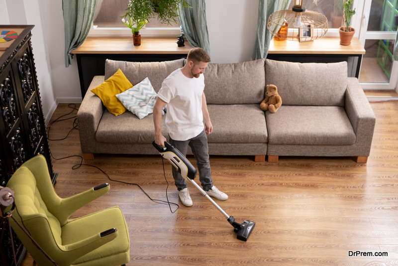 young-man-cleaning-Floor