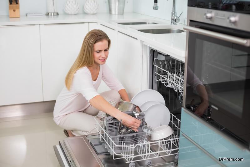 woman using dishwasher