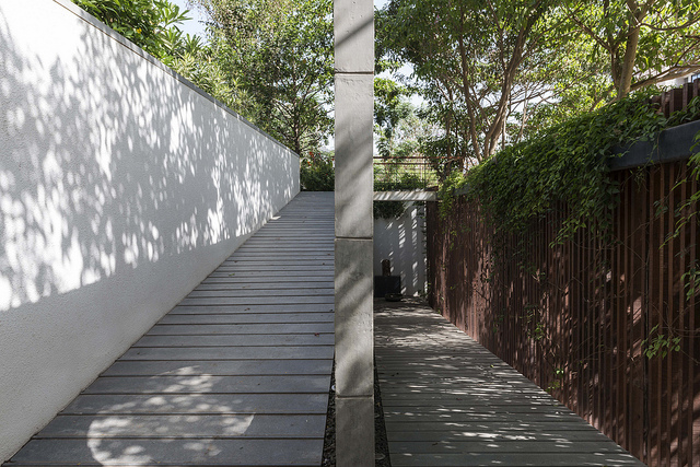 the pathway from the main gate leading to the garden of the house