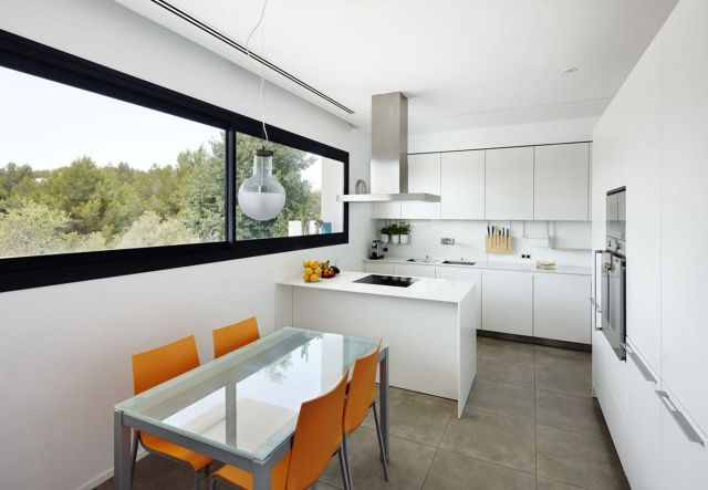 Minimalist Kitchen Combined with Dining Area
