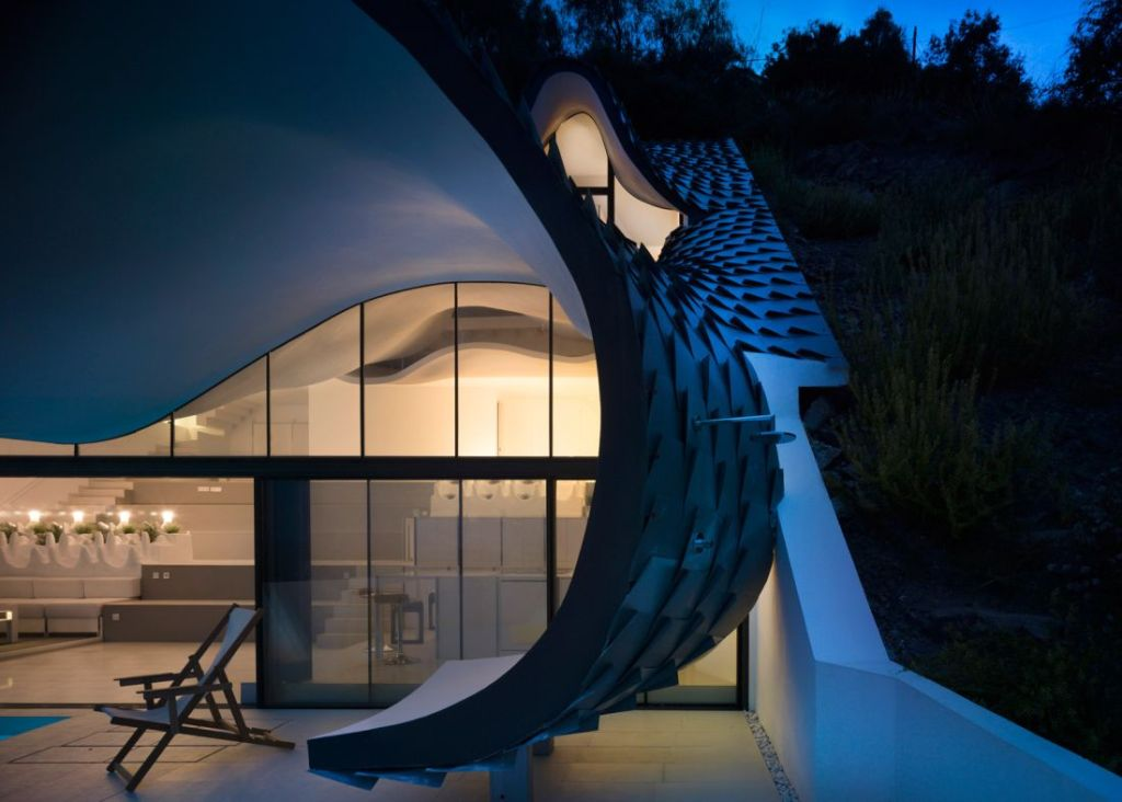house on a cliff night view
