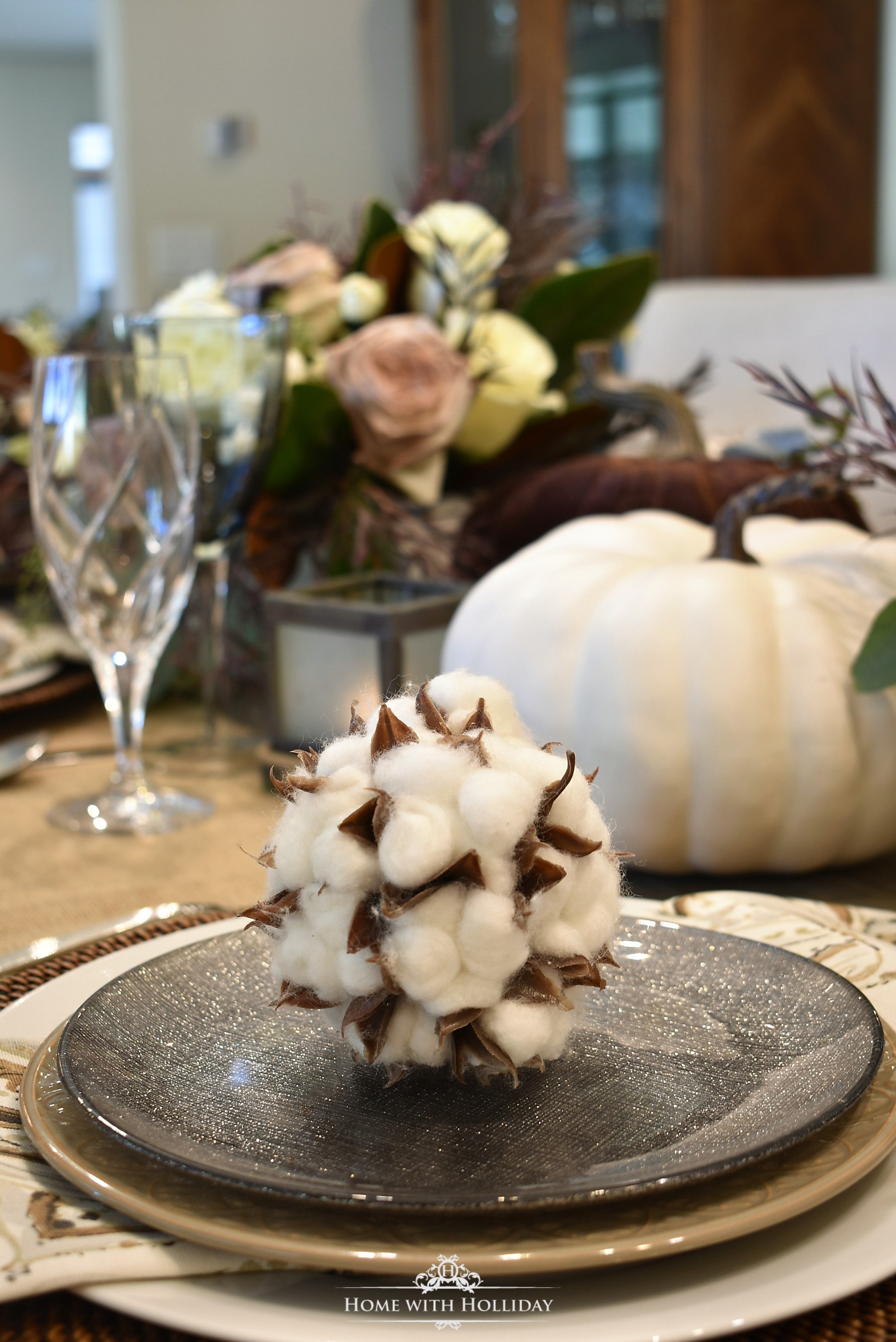 Place Setting for a Fall Table Setting with Brown and White Pumpkins