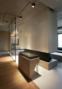 Penthouse with Concrete Ceiling and a Glass-Wall Windows