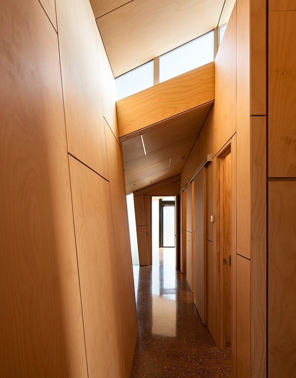 Rusted Steel Cladding House With Crafted Interior Finishes