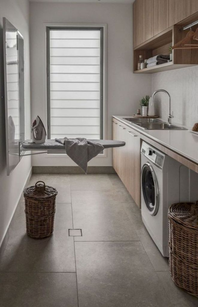 Laundry room storage with foldable ironing table 1 (source pinterest.com)