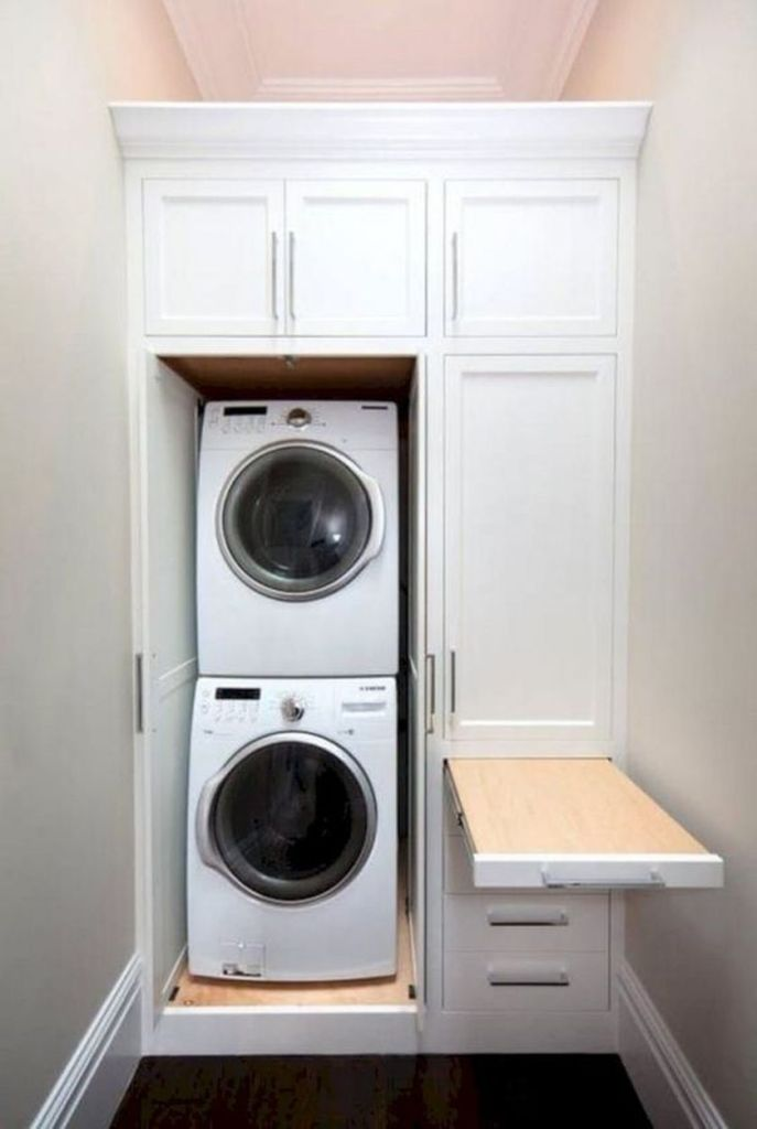 Laundry room storage with foldable ironing table 2 (source pinterest.com)