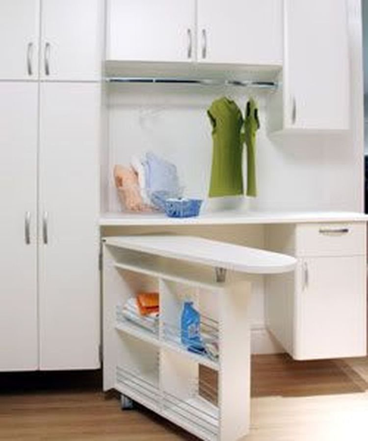 Laundry room storage with foldable ironing table 3 (source pinterest.com)