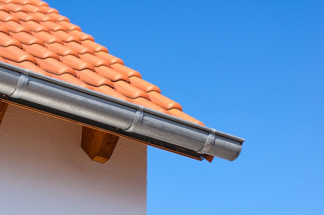 effective gutter on spanish style roof