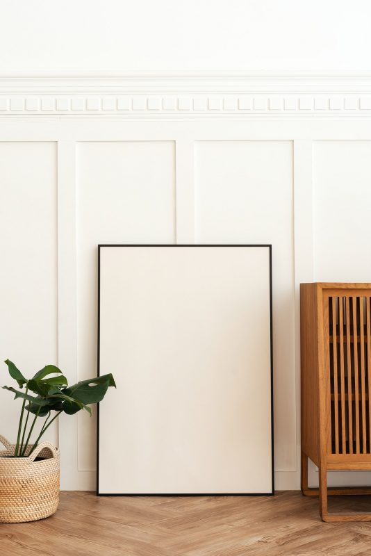 Blank picture frame on parquet floor | Royalty free photo - 2393014