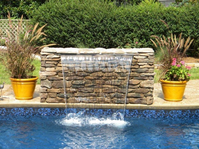 sheer descent waterfall into swimming pool | Pool waterfall, Pool fountain,  Backyard water feature