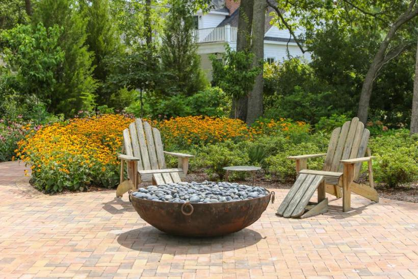 A Backyard Living Room with Fire Pit