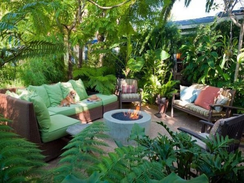 Shady Tropical Backyard with Fire Pit