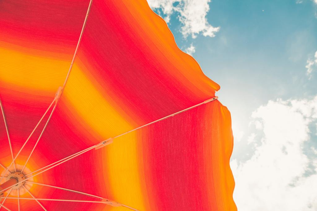 https://www.pexels.com/photo/low-angle-photo-of-red-and-orange-umbrella-1170594/