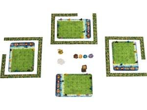 Spielaufbau von Karuba. Es sind vier Tableaus zu sehen.