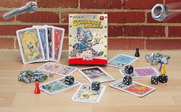 Spielaufbau des Spiels Schraube locker: Karten im Kreis mit Würfel und Pöppel