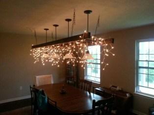 Magnificient Farmhouse Ladder Chandelier Ideas 16