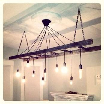 Magnificient Farmhouse Ladder Chandelier Ideas 27
