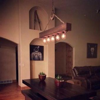 Magnificient Farmhouse Ladder Chandelier Ideas 37
