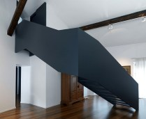 A-trendy-blue-gray-staircase-with-contemporary-minimalism
