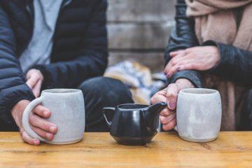 man and woman having tea and conversation