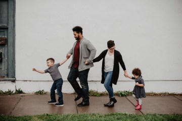 family of four walking together