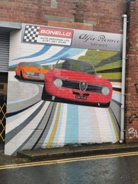 Art on the side of a garage on Stepney Bank