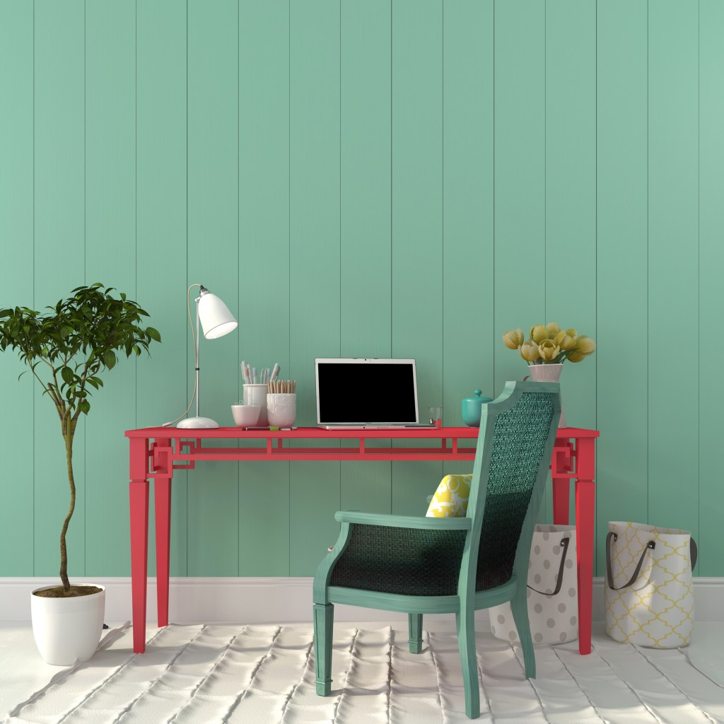 Relaxing office space with green wall background and red desk