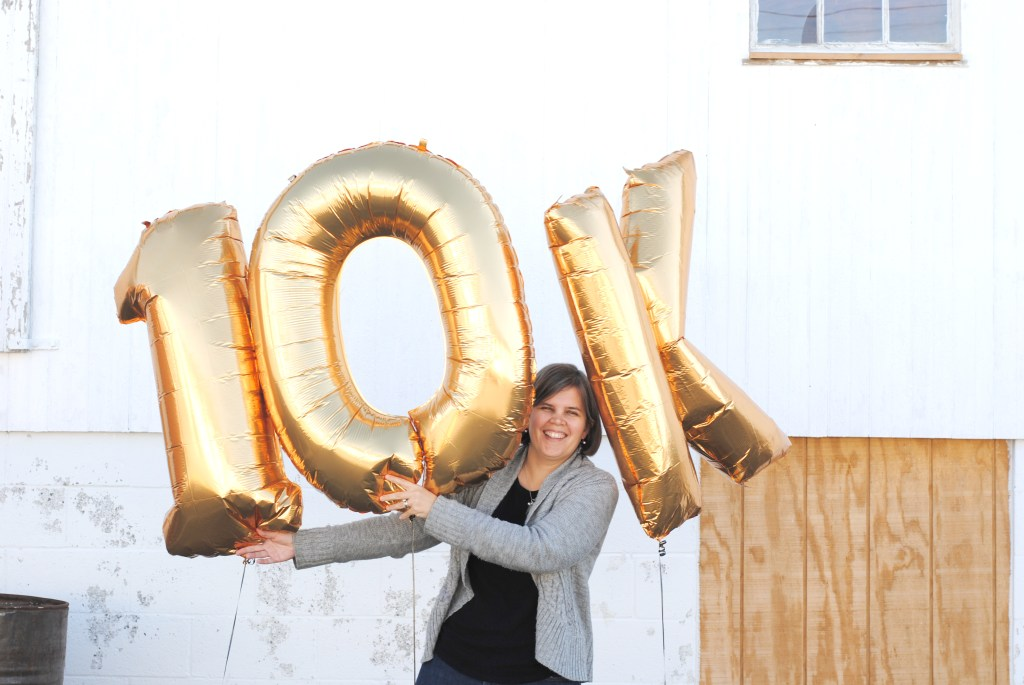 Woman standing with 10K balloons