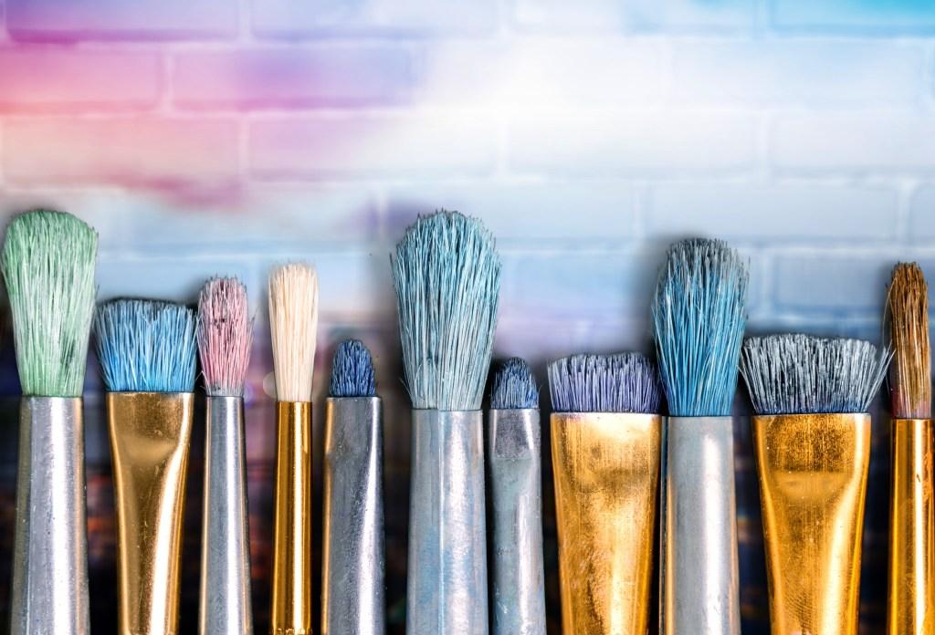 Rainbow of paint brushes