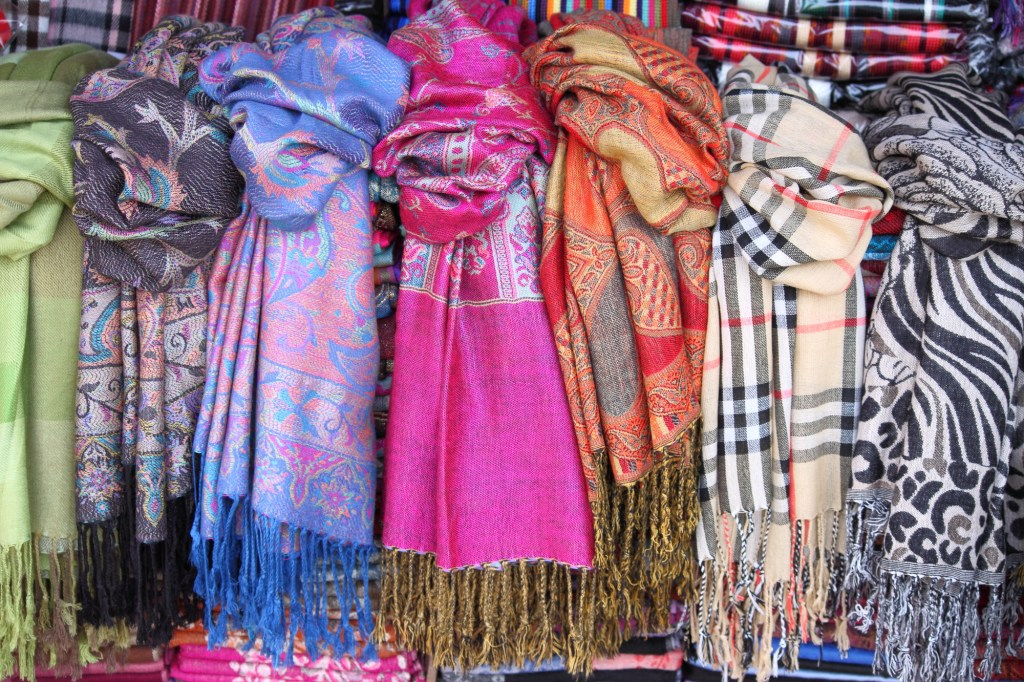 Colorful scarves hanging in shop
