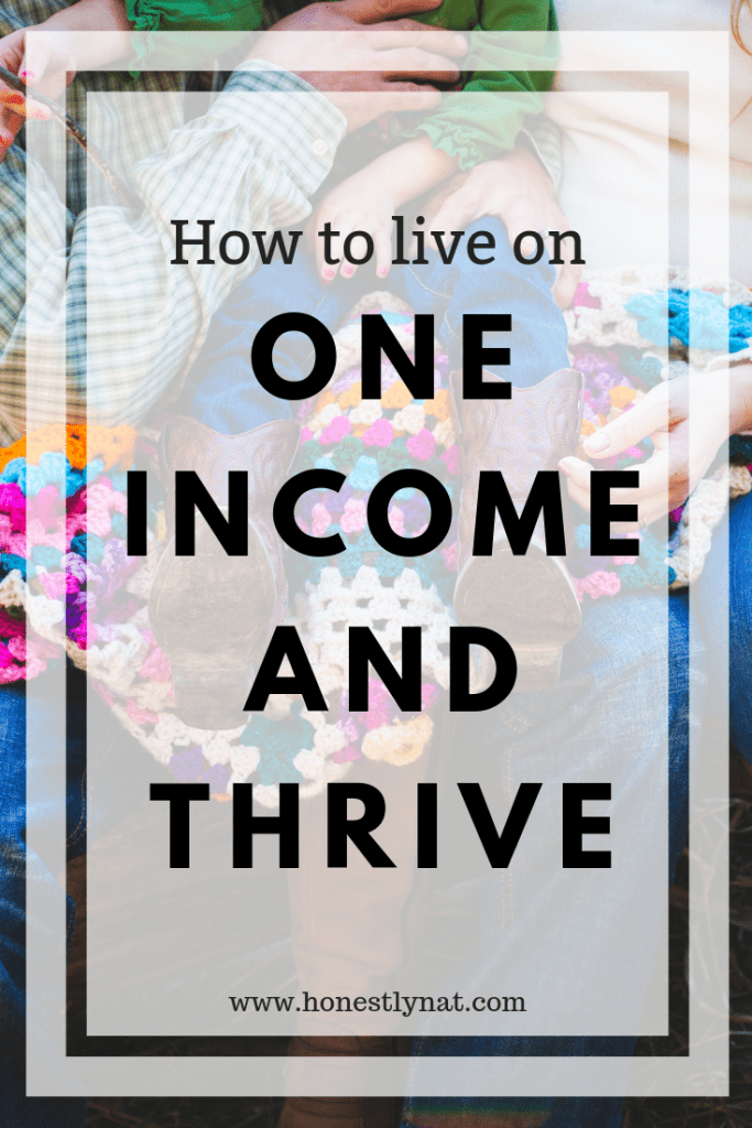 "Little girl with cowboy boots and sitting with her family - Text Overlay ""How to live on one income and thrive"""