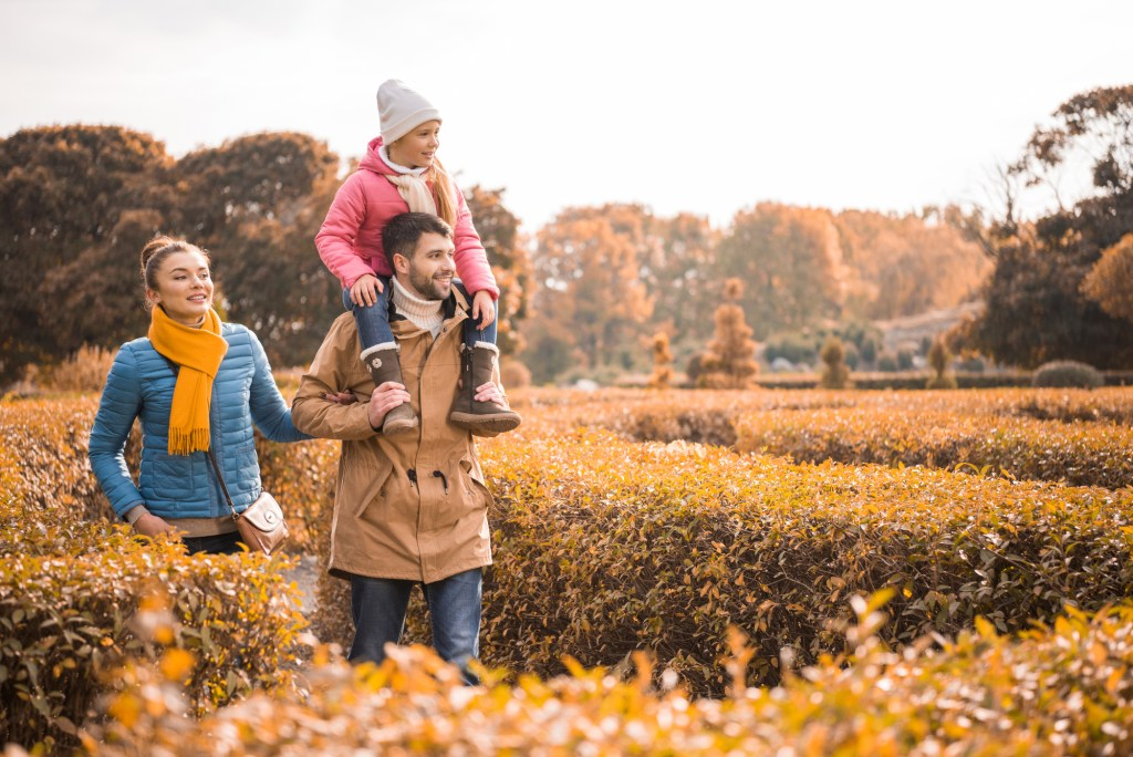 Family walking in a park in the fall