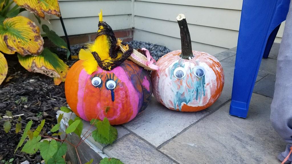 Adorable painted pumpkins on front porch