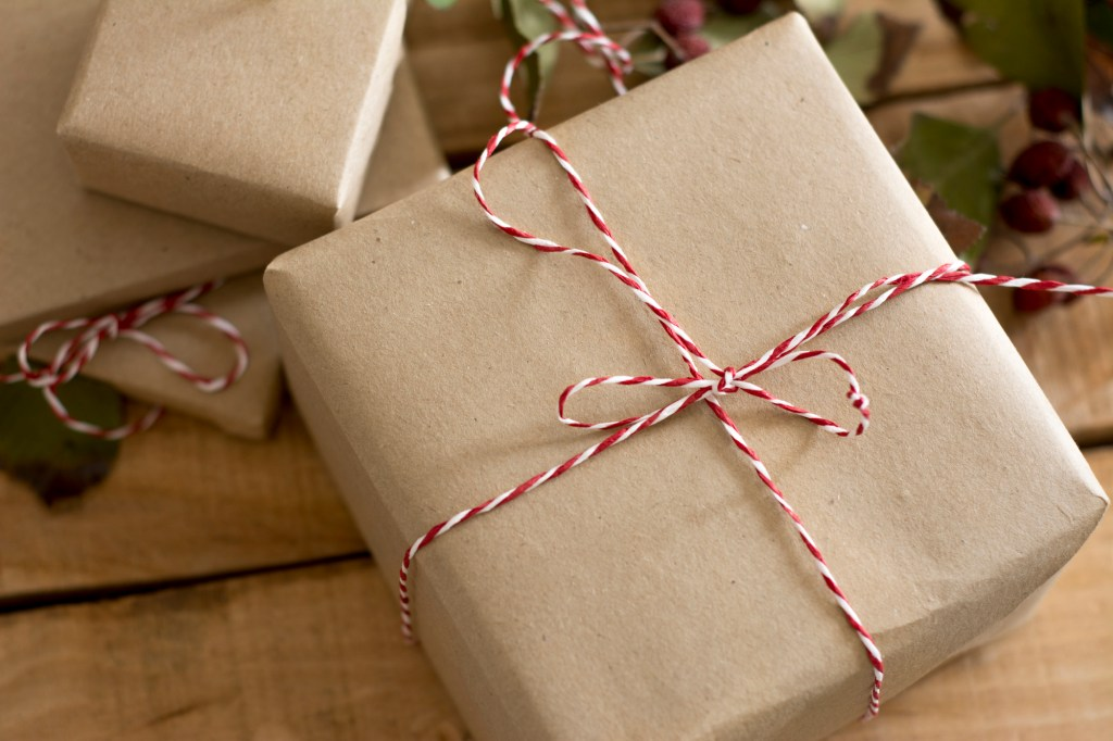 Brown paper package wrapped with red and white twine