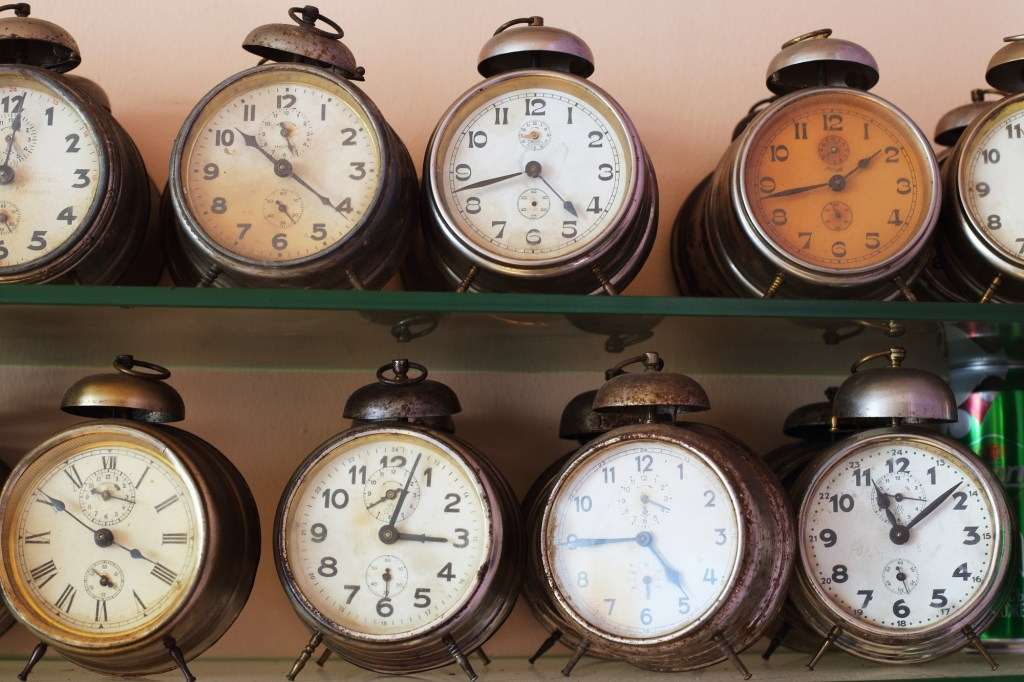 Vintage alarm clocks on shelf
