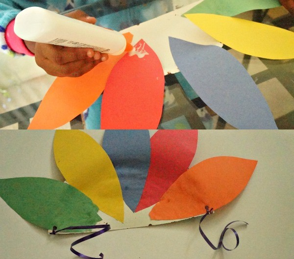 How to make a Thanksgiving paper plate turkey hat, gluing on the feathers