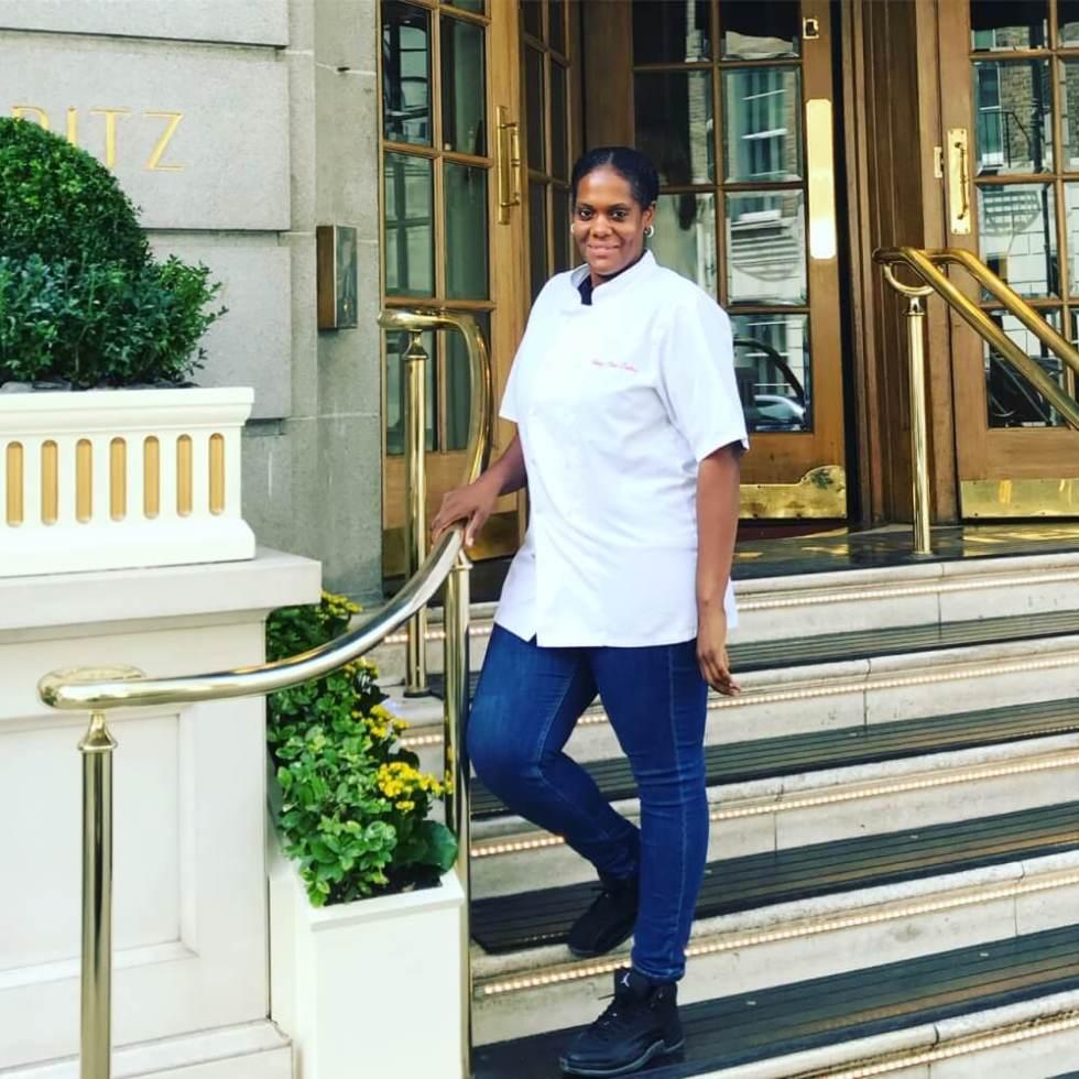 Melissa Gayner in chef whites standing on Honey Bees Cakes steps