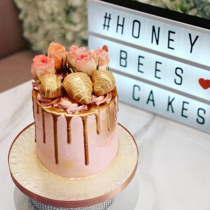 Rose gold drip cake with gold strawberries honey bees cakes