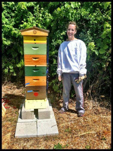Mary McElhinney and colorful hives.