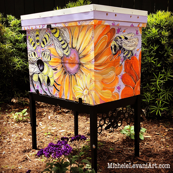 It will be a lucky colony indeed that lives within these muraled walls! The painting show honey bees and flowers in orange, yellow, and purple.