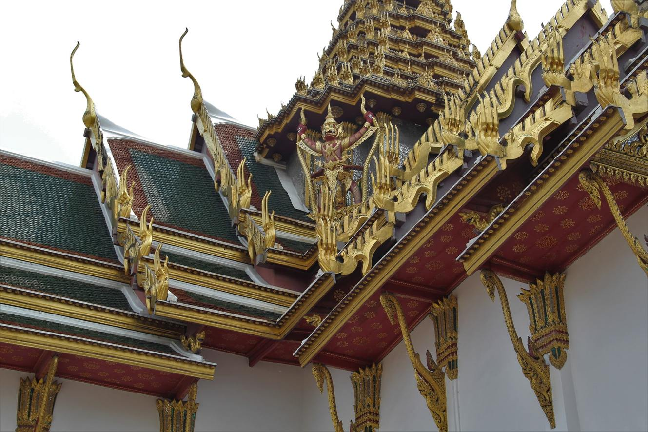 Bangkok Grand Palace roof decorations with a yak decorated in gold and red