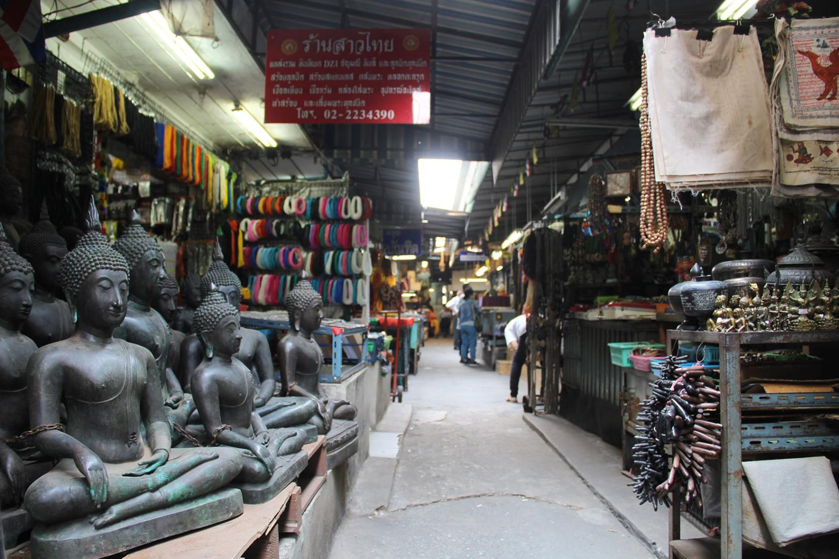 Bangkok amulet market with some Buddha statues up for sale