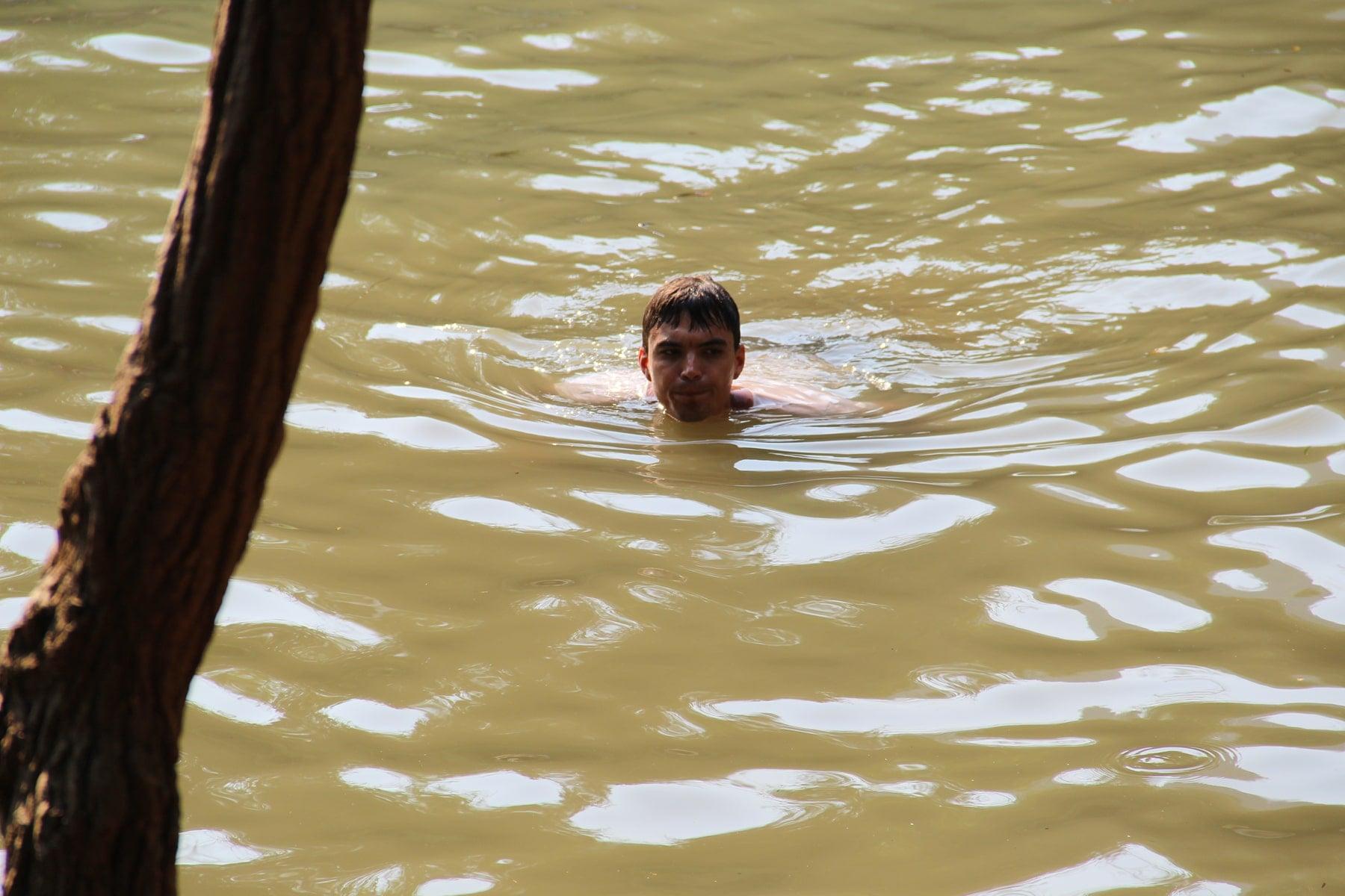 Swimming in cool springs Thakek loop