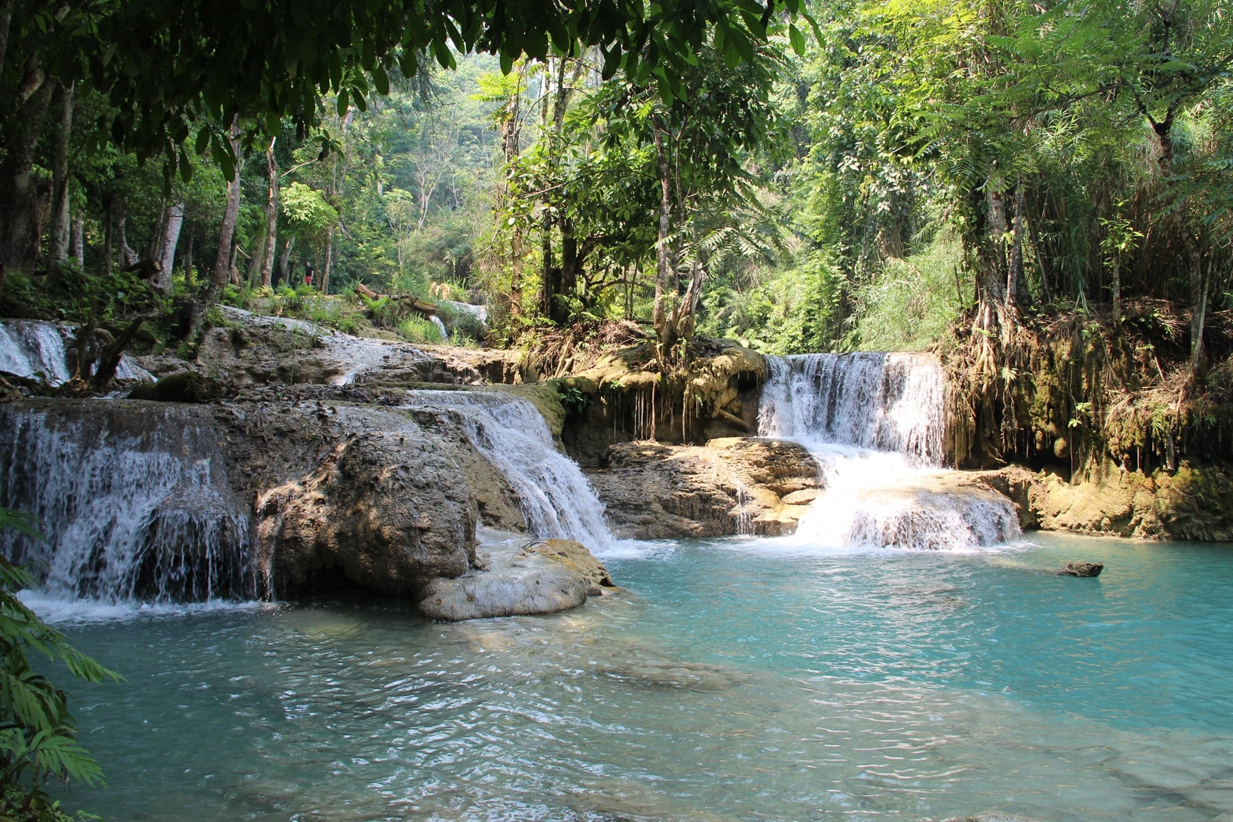 Little waterfalls in a pool in Kuang Si