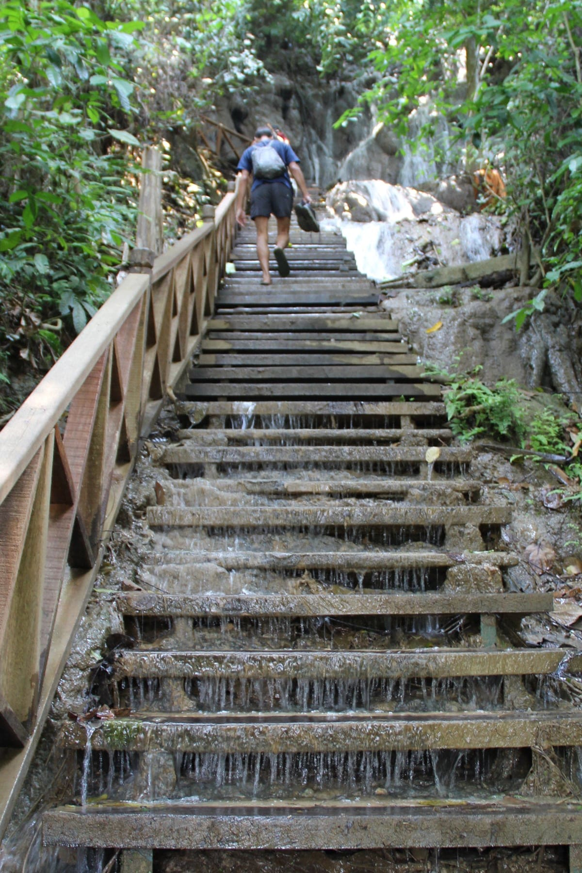 Stairs to reach top of waterfalls in Kuang Si