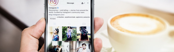 Instargram followers building on a mobile phone with coffee