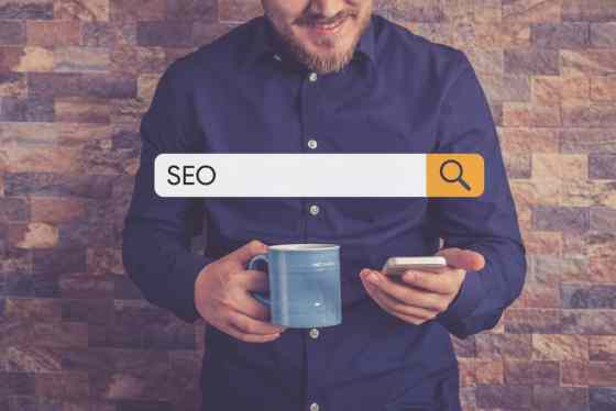 Search bar and man with mobile phone looking for WordPress SEO Checklist